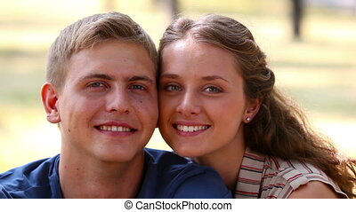Smiling sweethearts - Close-up of smiling young couple...