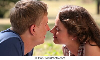 Sweet-talk - Close-up of adorable dates having a small...
