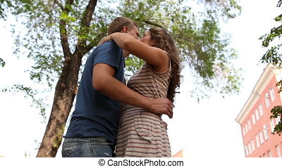 Long-awaited date - Girl and guy hugging expressing their...
