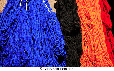 Coloured wool drying in the sun Marrakech Morocco
