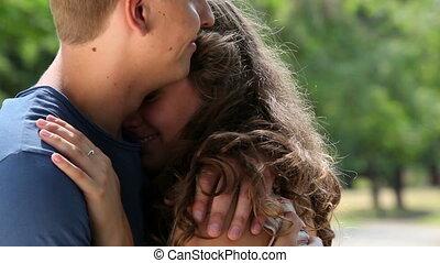 Sweet embrace - Tilt of a couple enjoying their sweet...