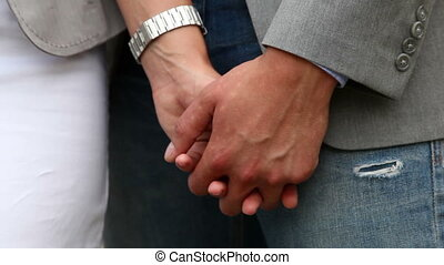 Affection - Close-up of a couple wearing business casual and...