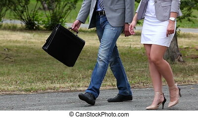 Business motion - People in business casual walking in step...
