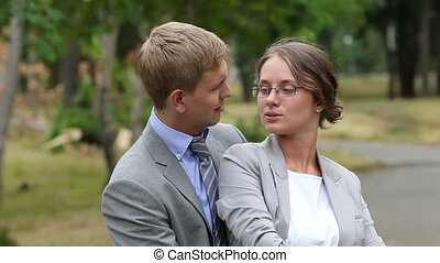 Business couple - Couple dressed in formalwear embracing...