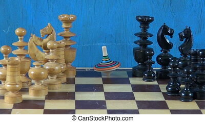 colorful wooden whirligig and chess