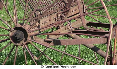old rusty agriculture horse rake tool in spring farm garden