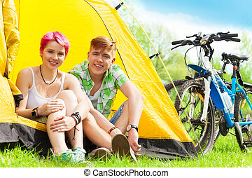 Couple sitting in a tent