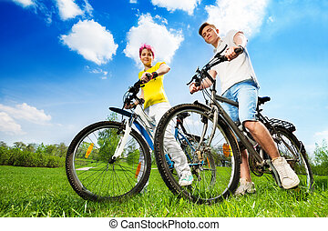 Happy young couple with bikes