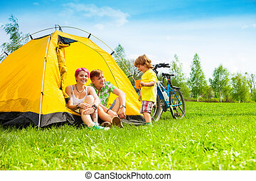 Yong couple with kid in a tent - Young couple with kid...