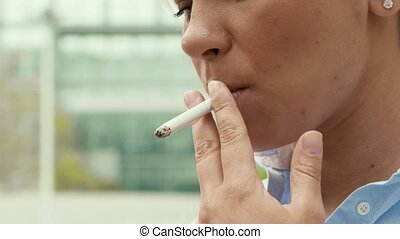 Business woman smoking cigarette - Young people and smokers,...