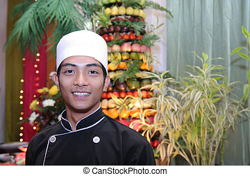 chef at buffet smiling