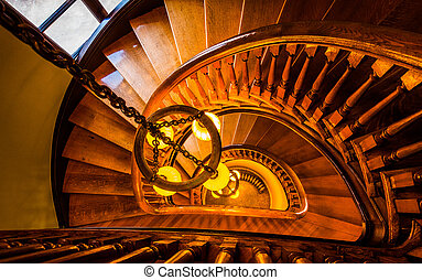 Looking down a spiral staircase in the Handley Library,...
