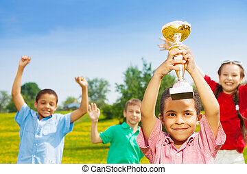 Champions - Close shoot of black happy smiling little boy...