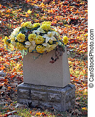 cemetery - silk flowers on a cemetery grave headstone