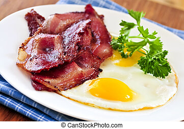 Bacon and eggs - Tasty breakfast of bacon and fried eggs