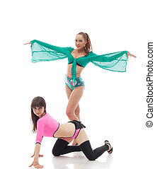 Smiling go-go dancers posing in colorful costumes