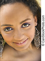 Adult woman making eye contact. - Close-up of young-adult...