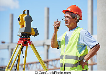 surveyor works with theodolite - One surveyor worker working...
