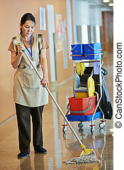 Woman cleaning building hall - Adult cleaner maid woman with...