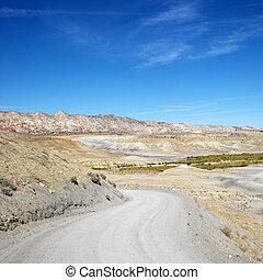 Desert road. - Gravel road in desert land of Cottonwood...