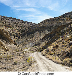 Cottonwood Canyon, Utah. - Dirt road winding through rocky...