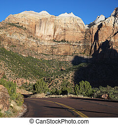 Zion National Park road, Utah. - Two lane road winding...