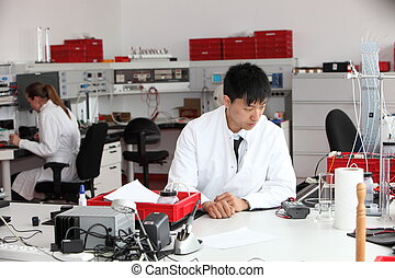 Young Asian laboratory technician - Young male Asian...