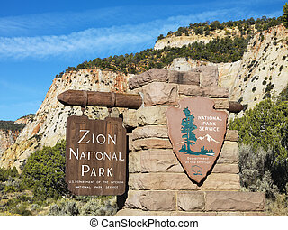 Zion National Park sign. - Wooden and stone sign for Zion...