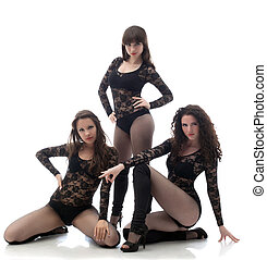 Alluring sexy dancers in black go-go costumes, isolated on...