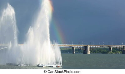 River fountain - Rainbow hanging over river fountain