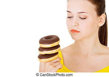 Woman with a pile of doughnuts Isolated on white