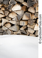 woodpile after snowing. Copy space