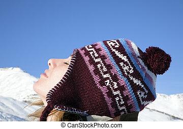 woman enjoying mountain - side view of young woman enjoying...