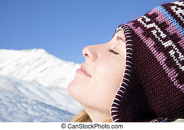 woman enjoying mountain - side view of young woman enjoying...