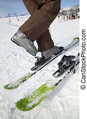 skier - Low section view of woman unfastening her ski boots