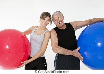 fitness - senior adult and daughter exercising with fitness...