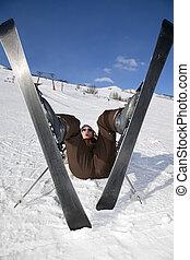 skier - beginner on skis falling down. Copy space