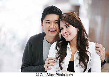Young adult asian family couple