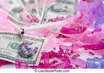 Glamour money and tablets scattered everywhere