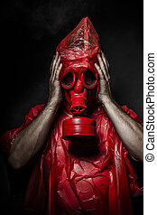 Military concept, man with red gas mask.