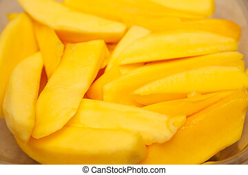 Mango Slices - Cut mango slices in a bowl closeup