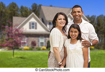 Small Hispanic Family in Front of Their Home - Happy...
