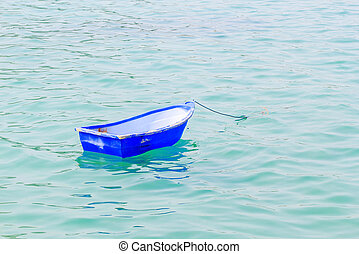 Punt - The old blue boat on the sea.