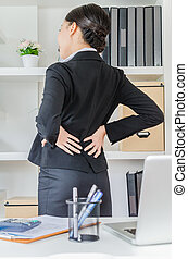 Backpain - Young business women back pain