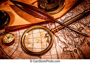 Vintage magnifying glass lies on an ancient world map -...