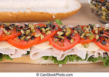Turkey Sub - Turkey sub with cheese, lettuce; tomato; and...