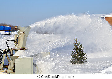 Snow blower - Snow being removed from a frozen lake with a...