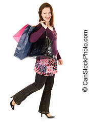 happy shopper woman - smiling woman holding shopping bags...