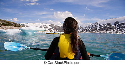 Kayak woman - Kayak at glacier lake, Styggevatnet,...