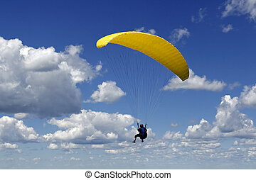 Paragliding - Paragliding in a deep blue sky